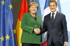 Merkel y Sarkozy pactan la recapitalización de la banca europea