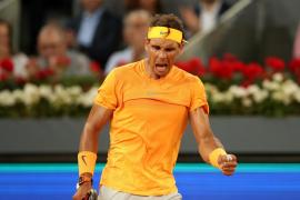 Nadal supera el récord McEnroe y pasa ronda en Madrid