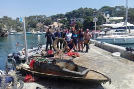 Un grupo de voluntarios retira más de 1.400 kilos de residuos del fondo marino en Cala Figuera