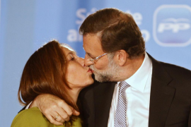 Spain's People's Party leader Rajoy kisses his wife Elvira after claiming victory in general elections in Madrid