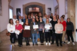 Palma homenajea a 31 comerciantes que regentan establecimientos en los mercados municipales desde hace más de 30 años