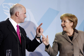 German Chancellor Merkel and Greek Prime Minister Papandreou gesture during a news conference after talks in Berlin
