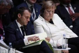 Merkel y Macron defienden el multilateralismo en un foro por la paz con la notable ausencia de Trump