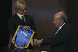 FIFA President Blatter shake hands with Italy's Farina during the FIFA Ballon d'Or 2011 soccer awards ceremony at the Kongressha