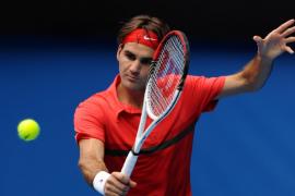 Federer salva el escollo de Karlovic y acompaña a Nadal a octavos de final