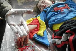 Encuentran 45 cadáveres, en su mayoría de mujeres y niños, en un barrio de Homs