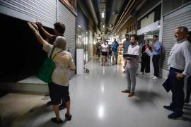 Cort recoge las llaves de sus locales de las galerías de la Plaça Major